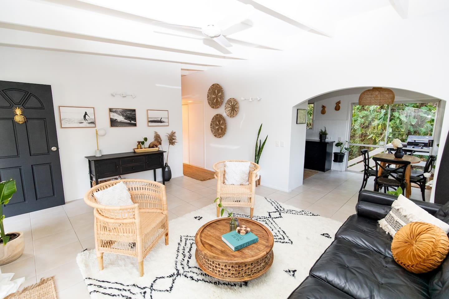 interior of a living room with black, tribal furnishings
