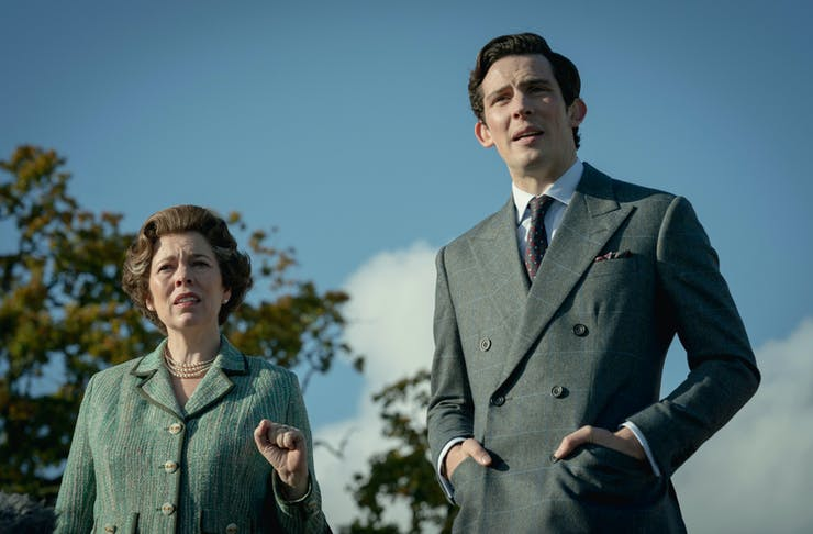 A photo of actress Olivia Coleman and actor Josh O'Connor against a blue sky backdrop, playing the roles of Queen Elizabeth II and Prince Charles, respectively.