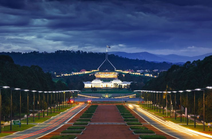 A view of parliament house at dusk in Canberra