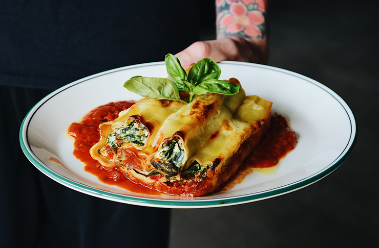 Tipico's famous spinach cannelloni covered in ricotta.