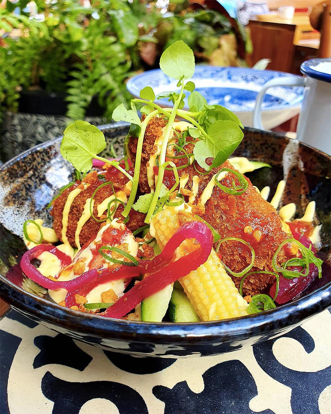 Vegan Tempeh Croquettes.  Pickled Baby Corn, Shallots, Sweet Chilli Relish Vegan Mayonaisse, Cucumber at Tok Tok.