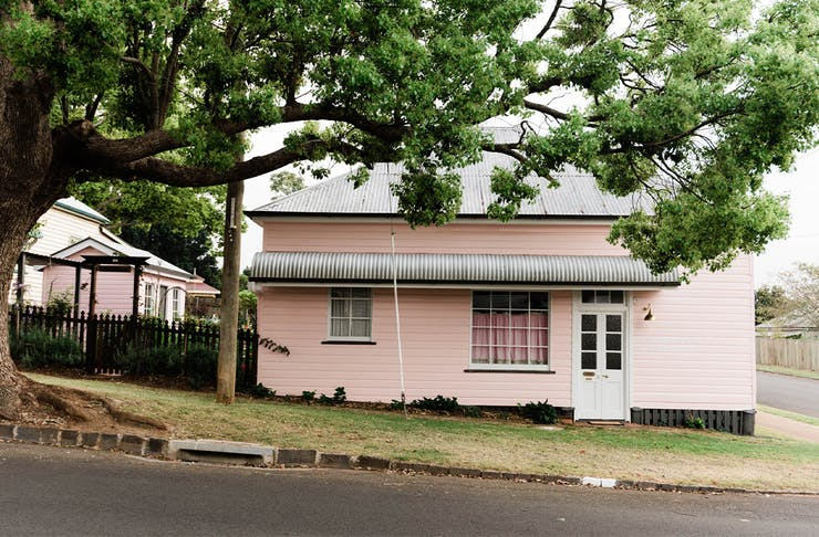 exterior of a cottage painted pink