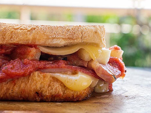 A close-up shot of a delicious, gooey toastie.