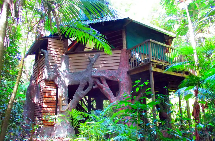 An octagon-shaped treehouse built in between several trees in Queensland's Daintree Forest.