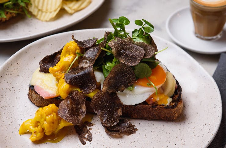 leg ham tartine that's made with a truffle-infused fried egg