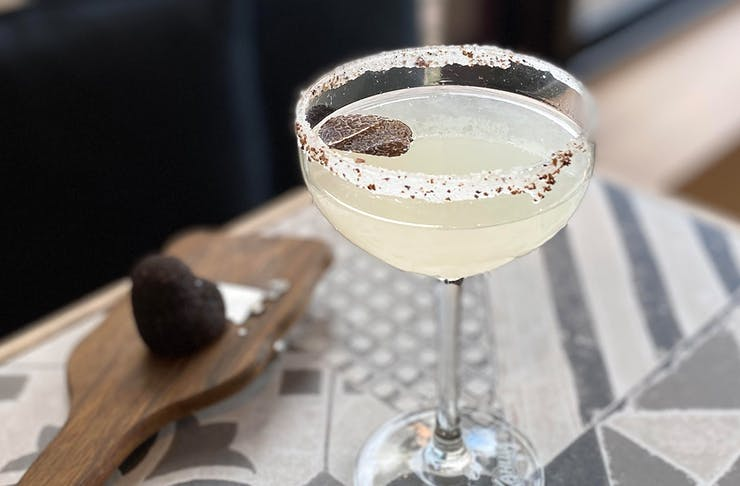 a margarita with a truffle shaving on top