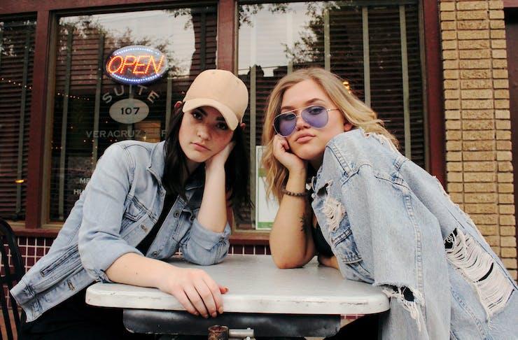 Girls sitting outside a bar