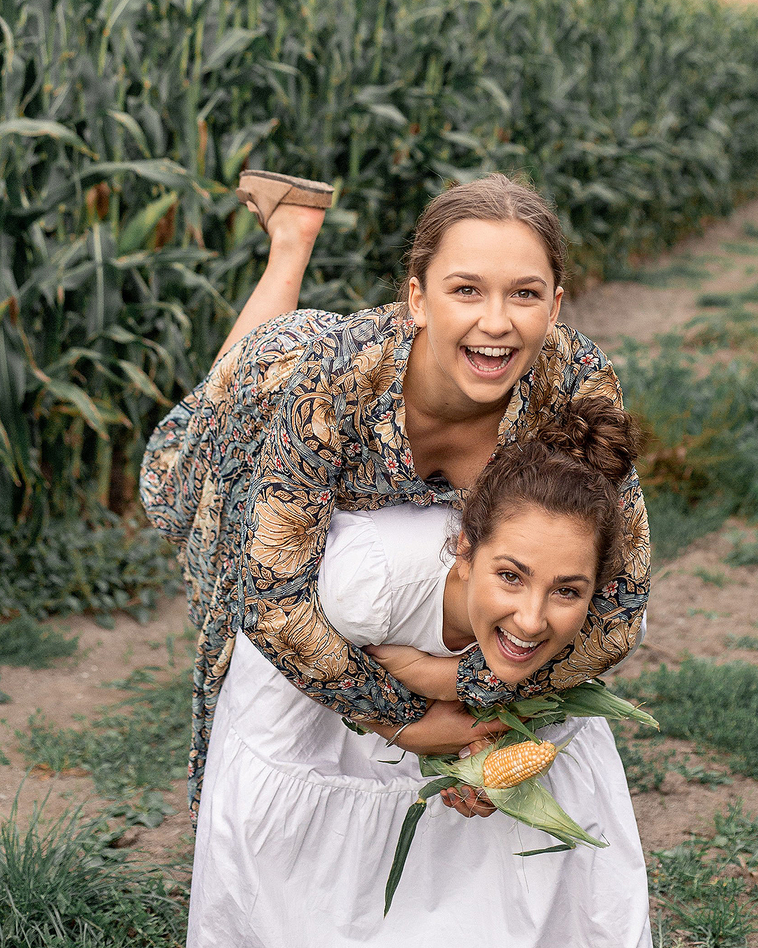 Margo and Rosa play around in a field.