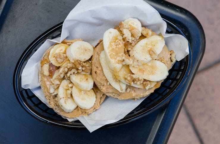a banana and peanut butter topped bagel