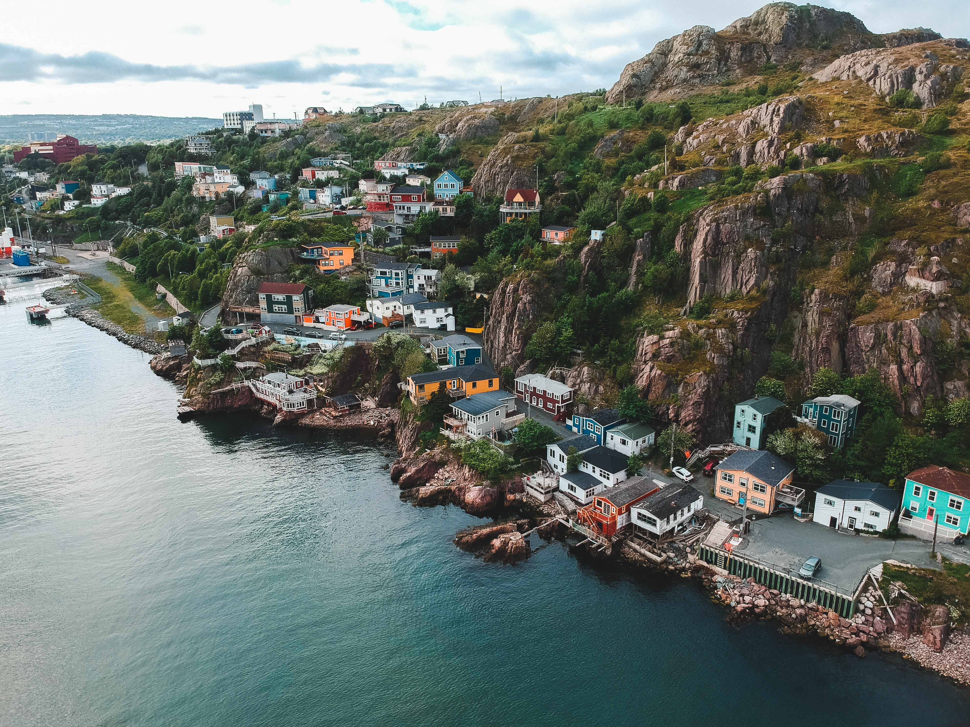 a cliffslide in newfoundland dotted with colourful houses