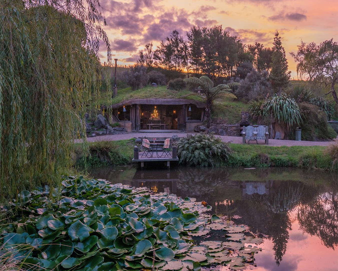 Underhill Valley is seen in front of a beautiful pond at sunset.