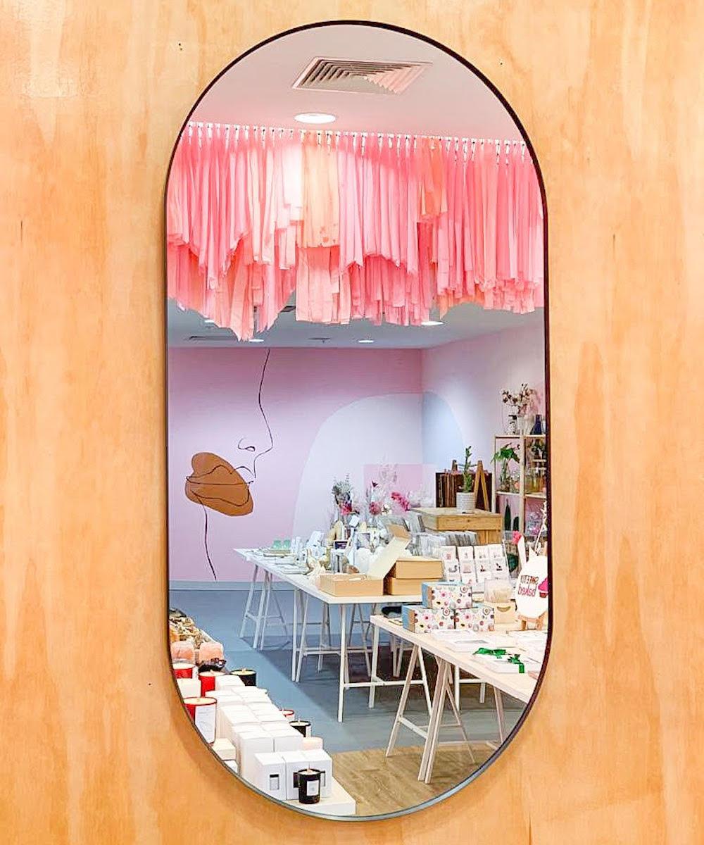 Mirror reflects interior of Market Hub