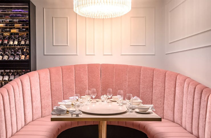 a pink table booth at donna chang