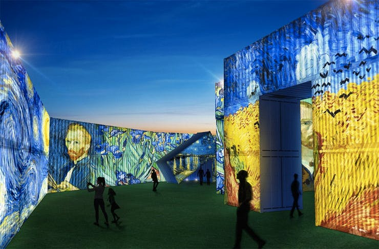 A render of the Van Gogh Alive exhibition showing people wandering amongst huge shipping containers.