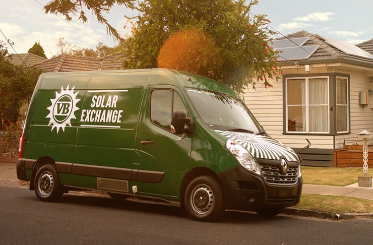a green van with a sign that says