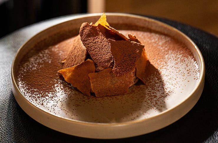 A vegan mousse on a flat plate.
