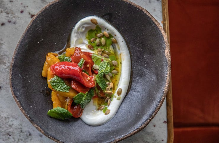 a bowl of labneh and marinated capsicum