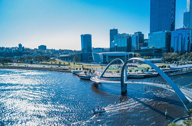 A bridge passing over a waterway in Perth CBD on a sunny day.