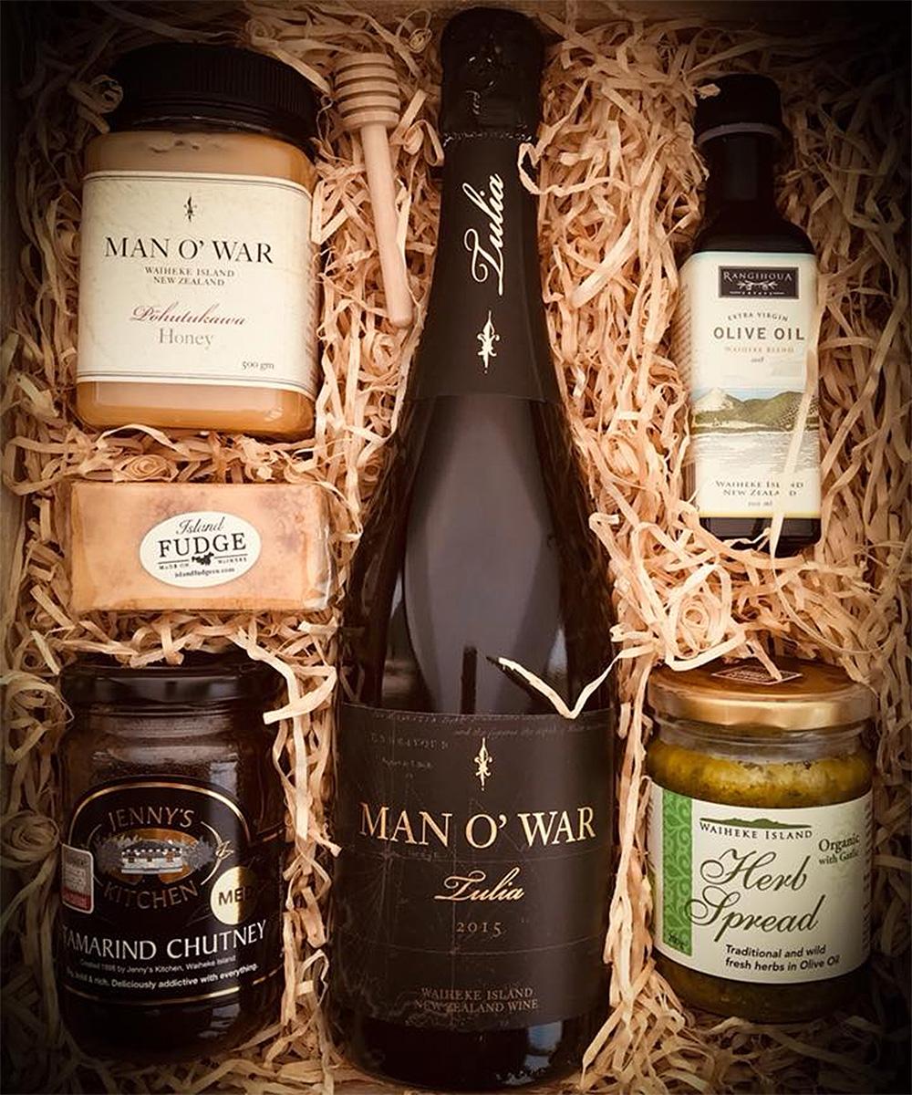 A gift box from Waiheke Hamper Co showing wine, honey and other assorted Waiheke goodies.