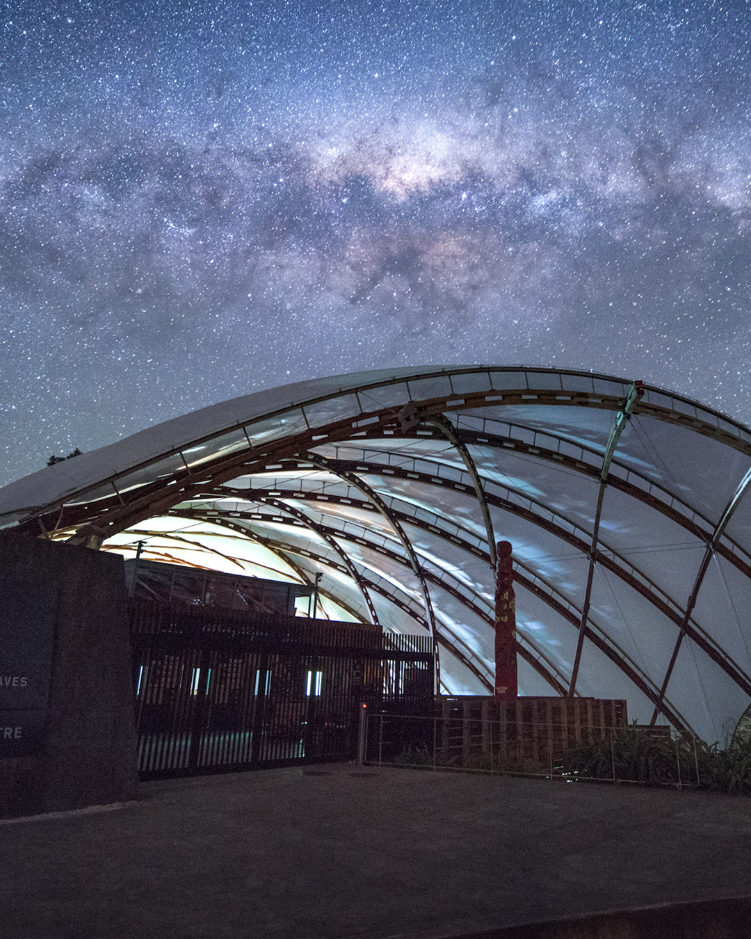 Waitomo Caves Township under a starlit sky.