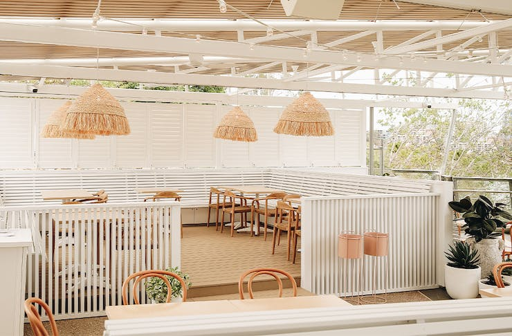 a white dining area overlooking the brisbane river at joeys