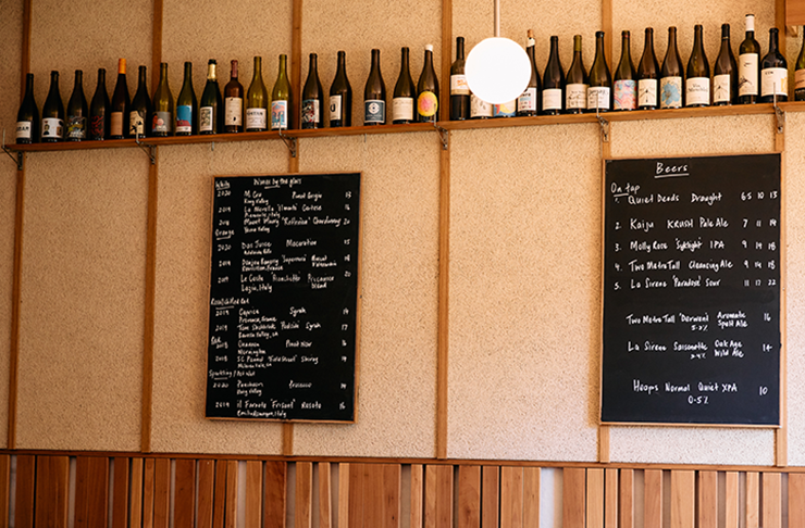 The specials board at a wood-furnished wine bar.