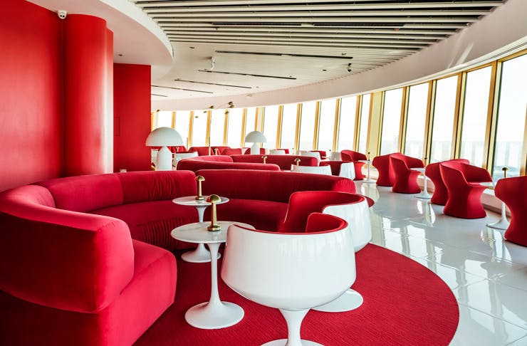 The retro-style red plush couches at Bar 83 in Sydney.
