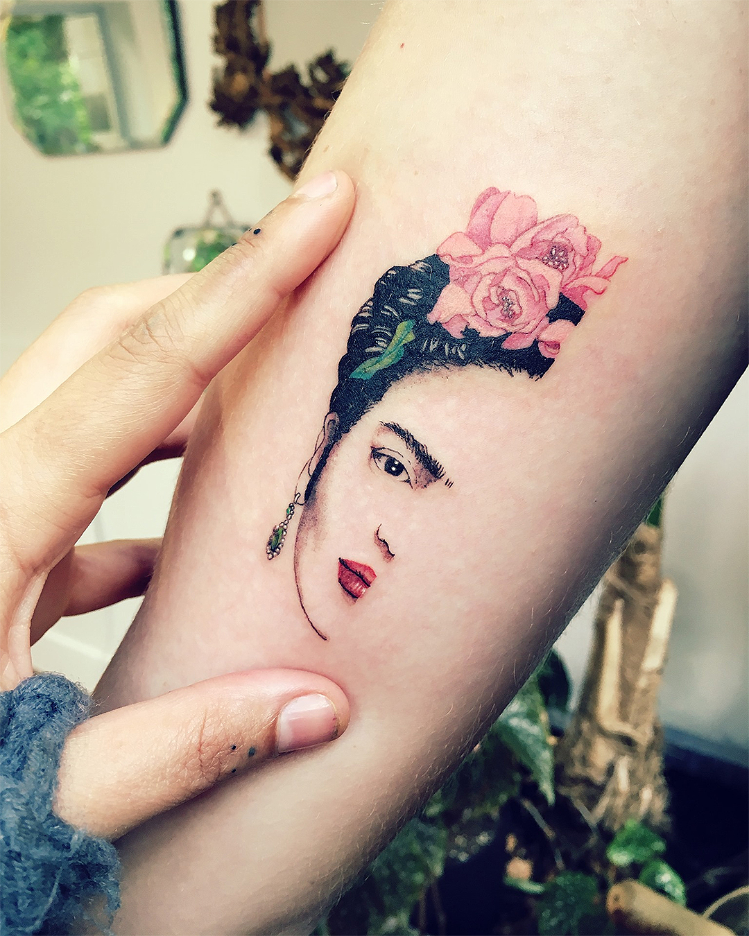 Frida's half face beautifully etched on someone's forearm.