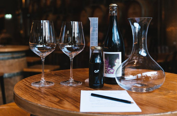 wine glasses and a wine bottle on a round table