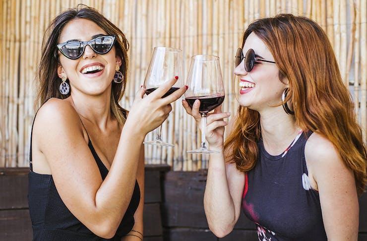 Two ladies enjoy a good drop of Pinot Noir.