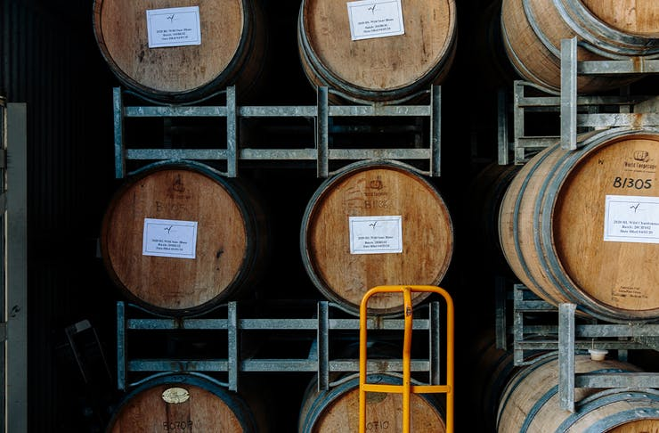 wine barrels stacked in a framework