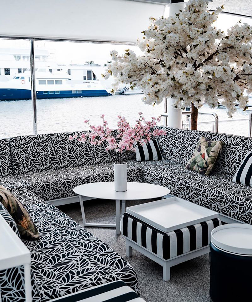 A couch area on Yot Club