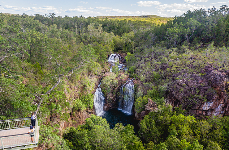 two people standing on viewing platform looking at florence falls