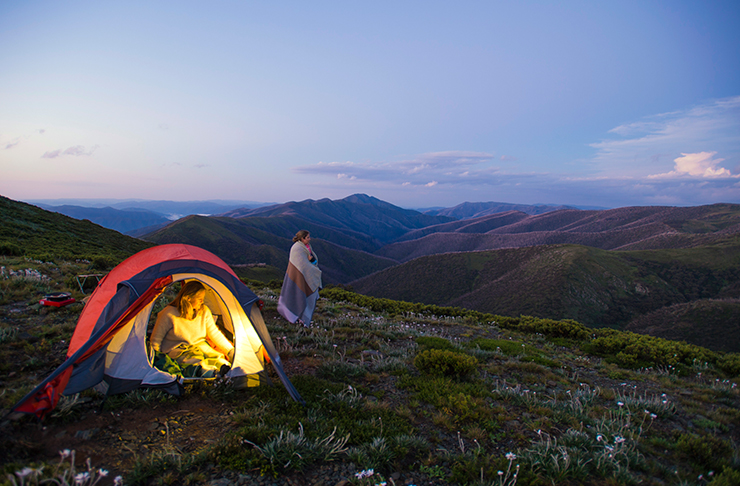 two people camping on top of mountain