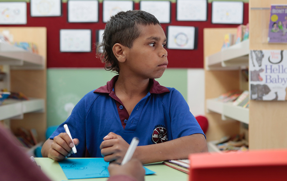 Dujuan from In My Blood It Runs sits in a class room wearing a blue shirt.
