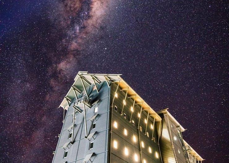 a close up of a hotel at night