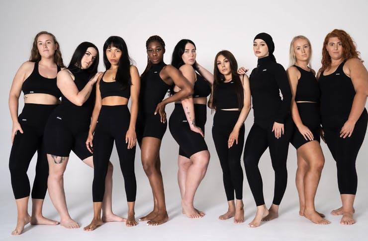 diverse group of girls posing in black activewear