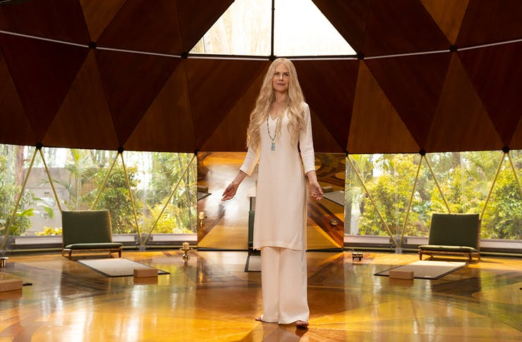 An ethereal looking woman in a round room.