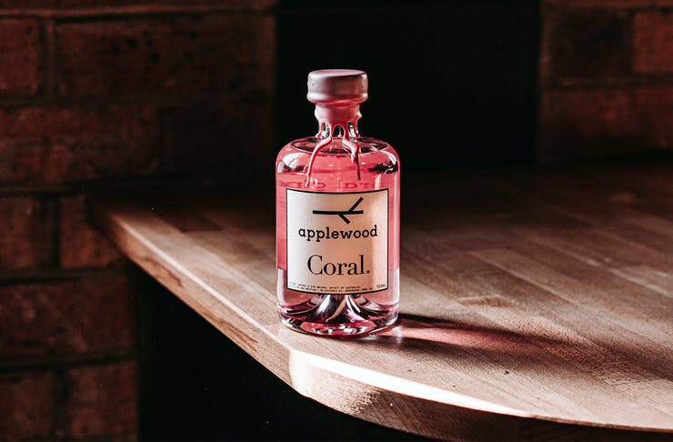 a bottle of pink gin on a table