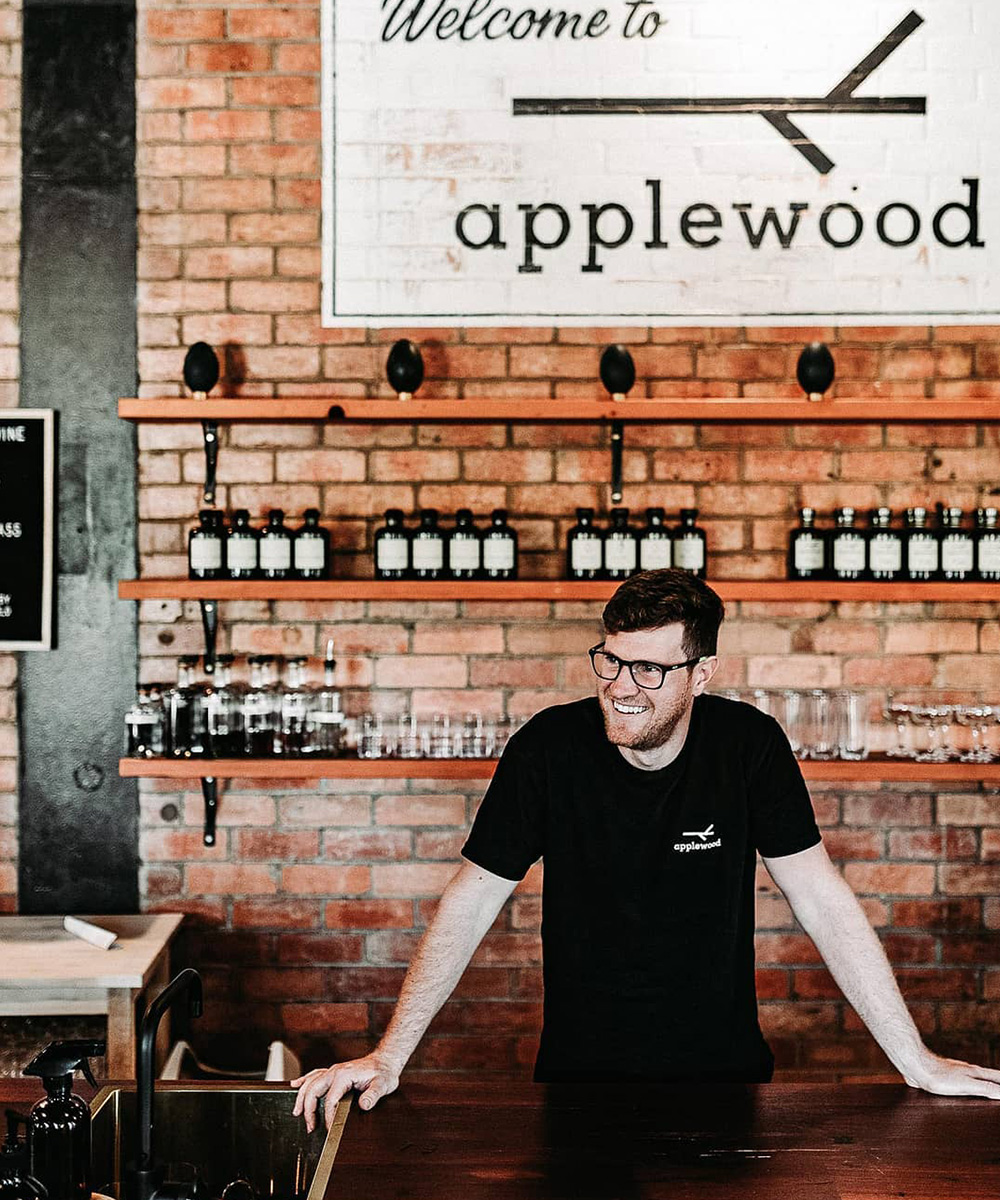 Applewood founder Brendan Carter standing behind the counter in the distillery
