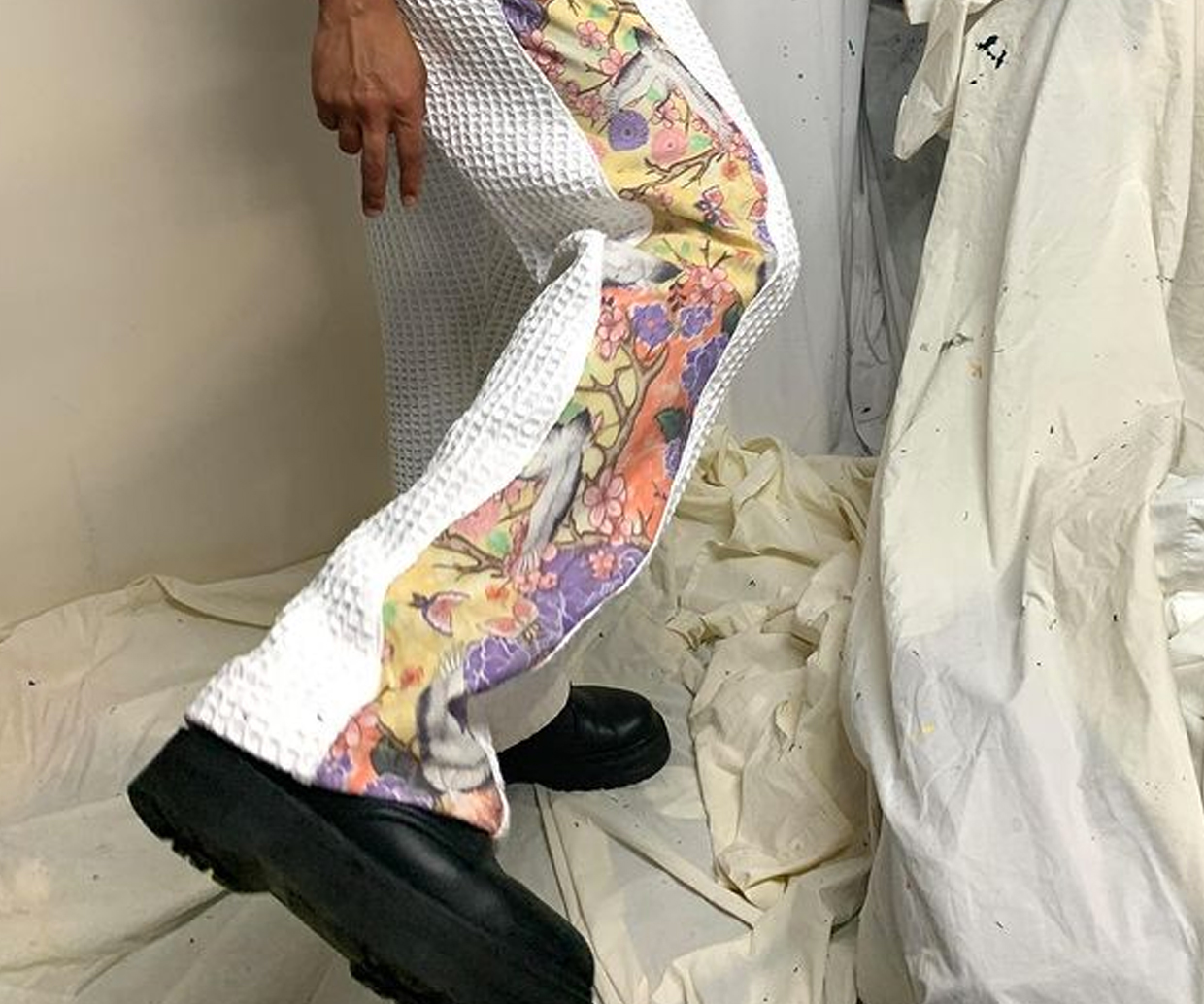 groovy pants on person kicking leg up