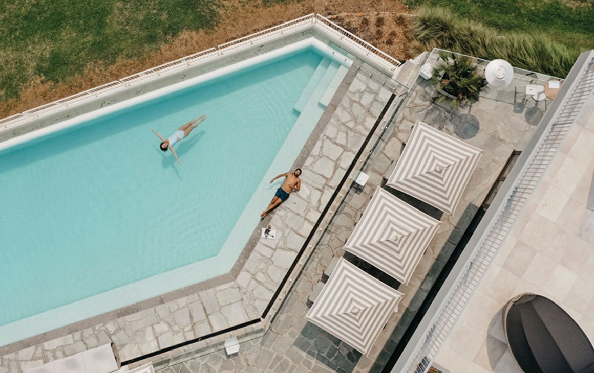 a woman floats in the pool at Bannisters Port Stephens