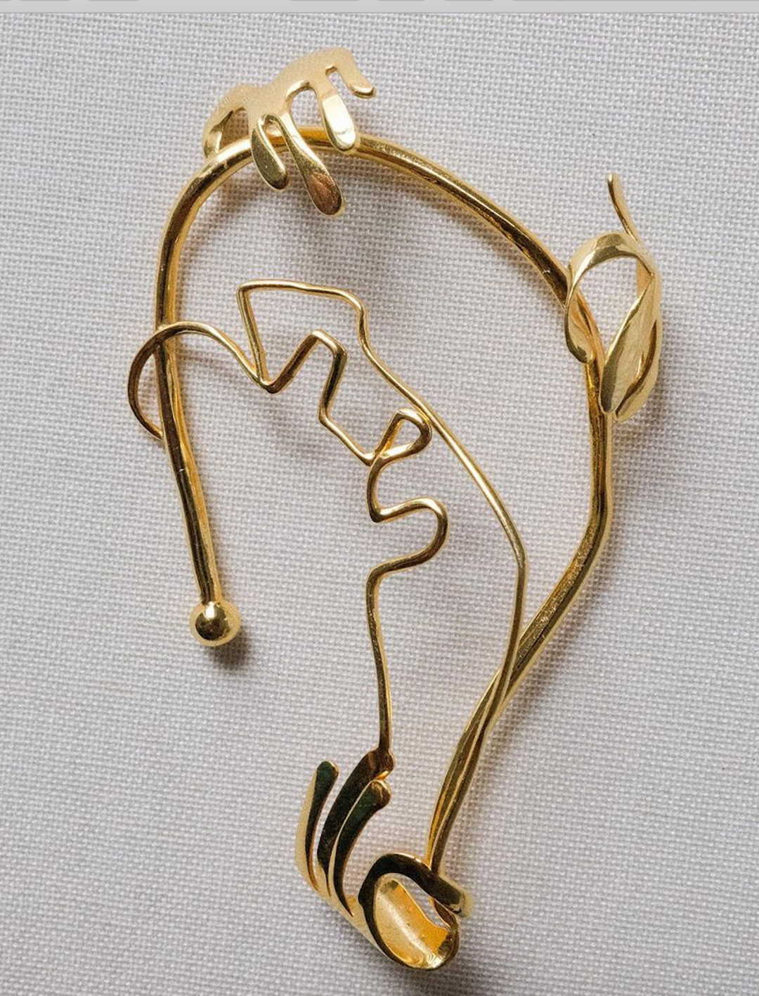 a piece of gold ear jewellery