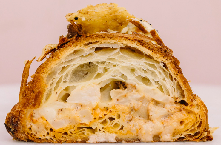 cauliflower cheese twice baked croissant with brushed harissa oil, filled with bechamel and mozzarella