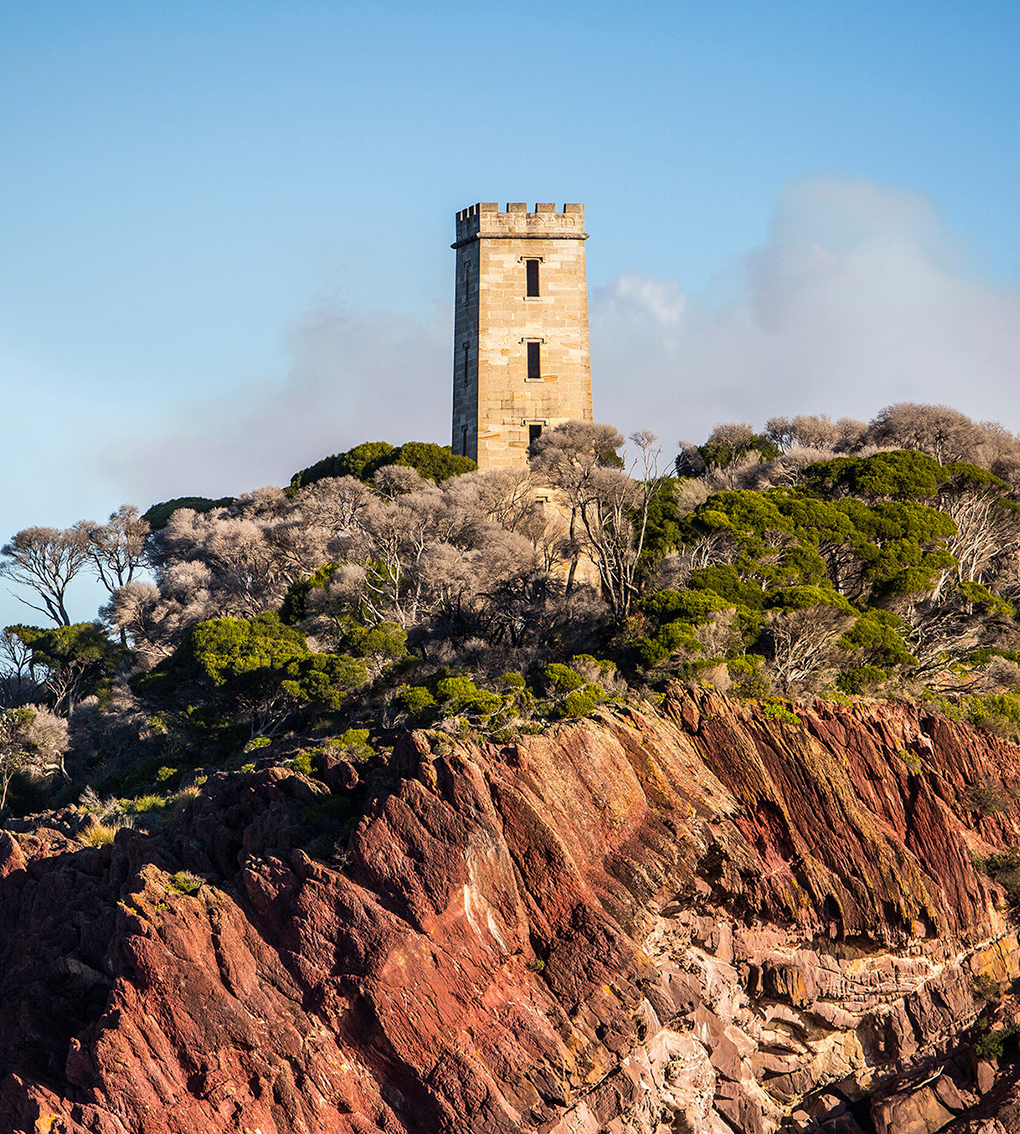 ben boyd tower on cliff at sunset
