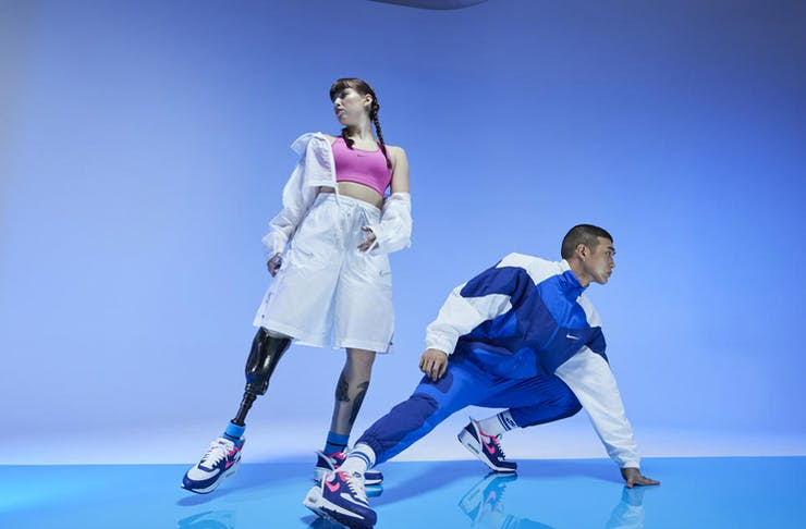 two people wearing nike's go flyease sneakers