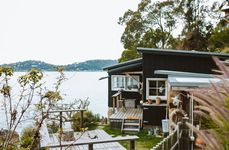 old beach shack in sydney's pittwater on the cliff decked out with nautical vices