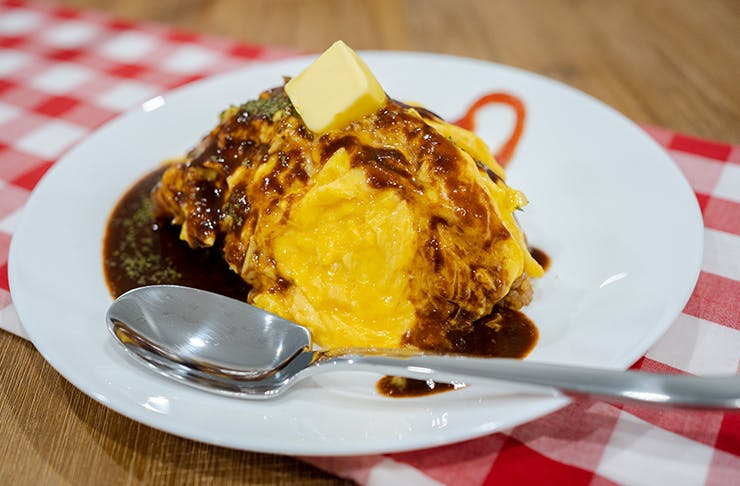 plate of omurice with demi glace sauce