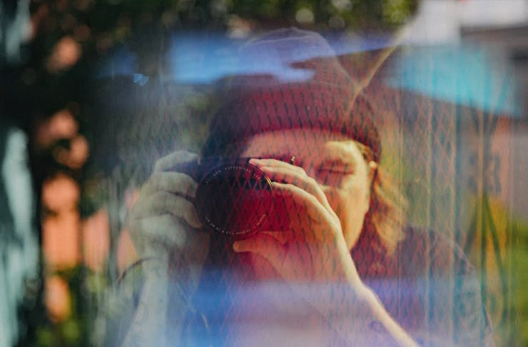 man holding camera up to face