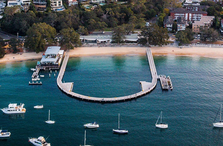 aerial view of balmoral beach, boats floating in calm water
